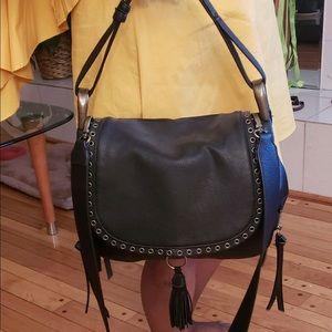 A black leather Steve Madden crossbody purse.